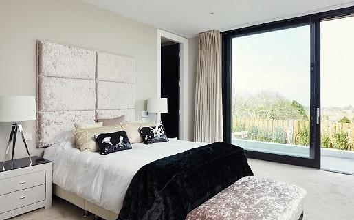 Bedroom with Black Sliding Glass Doors